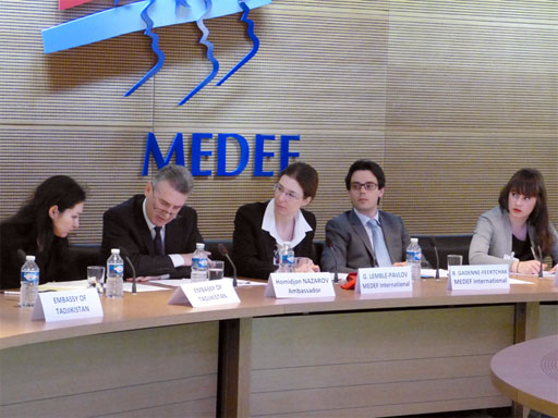 Photo of conference and MEDEF logo